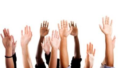 voting hands raised